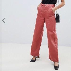 Pink high waisted wide leg cargo pants.